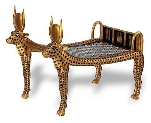 "<span class=""caption_text"">Cow Mehetweret Bed Couch from Tutankhamun's Tomb. It is guilded as an image of Mehetweret(""the Great flood""</span>"
