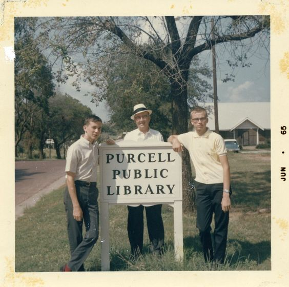 Doug, Daddy and Michael at the Purcell (Oklahoma) Public Library sign.