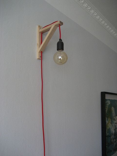 #diy hanging light. looks like bulb threaded through an ikea shelf