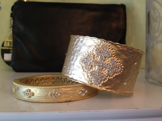 Gold cuff and bangle by Be-je.  Lots of jewelry at frenchy's