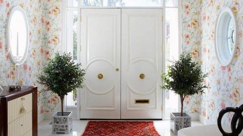 These white lacquer double doors with the floral wallpaper is so fab for Spring!