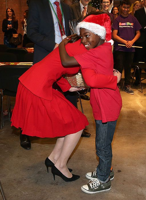 Kate drums up some festive cheer at children's Christmas party - Photo 8