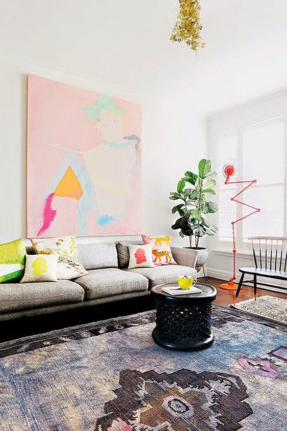 In the Melbourne apartment of artist Miranda Skoczek, a candy-colored painting by Rhys Lee is situated above a sofa from Aero Designs.: