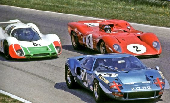 Monza 1000km, 1969. Pedro Rodriguez in the Ferrari 312P manages to pin Jo Siffert in the Porsche 908 behind a back marker in the last event staged on the high banks of Monza. Siffert and co-driver Brian Redman won the race.