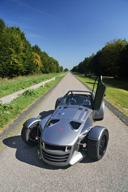 DonkerVOORT D8 GTO--Dutch and 1532lbs.  Engine is a Turbo 5 cyl from Audi's TT RS.   Zero to 62mph in 2.8 seconds.