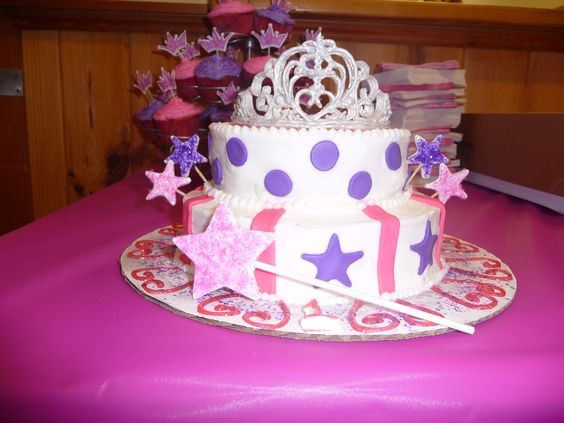 Princess Daniella's Cake - My first completed cake for my friends daughters first birthday.  It was the one she devoured!  Tiara is made of royal icing, cake is frosted with white frosting and decorated with fondant, stars and wands are gumpaste