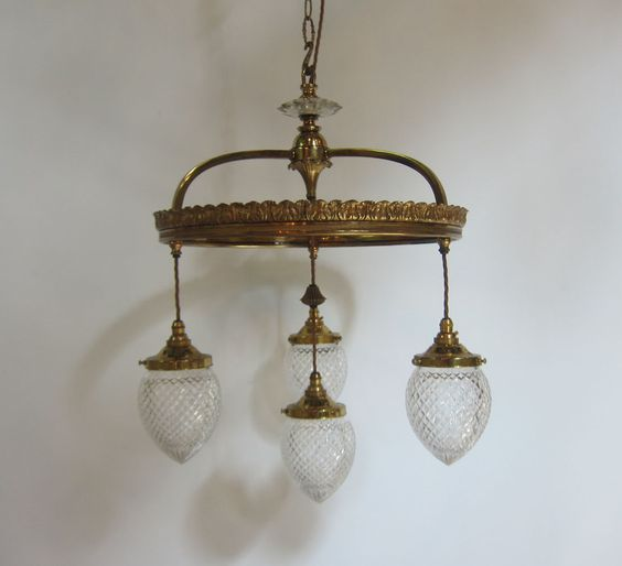English four arm ceiling light in the original gilt brass finish and complemented by period cut glass shades. www.antiquelightingcompany.com
