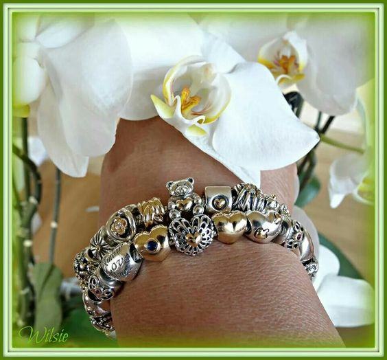pandora bracelets with gold and silver charms featuring. Black Bedroom Furniture Sets. Home Design Ideas