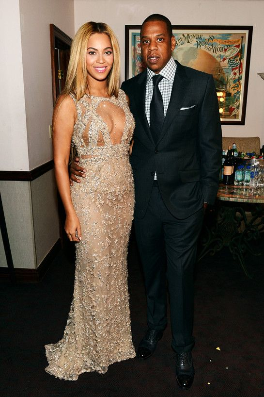 Beyonce and Jay Z's outfits for Beyonce's premiere movie Life Is What A Dream: Beyonce is wearing a sparkly diamond dress with a silk and straight hair dew: Jay Z is wearing a black Tux with a plaid shirt underneath: