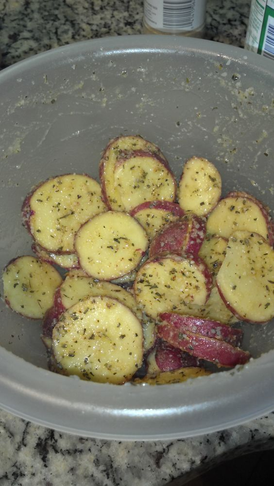 """My """"shake & bake"""" roasted Parmesan potatoes.     Red potatoes  Light olive oil  Italian seasoning  A little salt  Garlic powder  Parmesan cheese    Bake at 325 degrees for about 20 and boom! A yummy side if I do say so myself."""