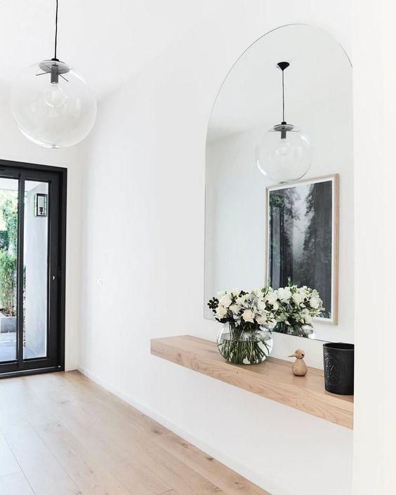 Fresh Minimal Modern Entry With Light Wood Floors And Accents Glass Pendants Black Glass Door Scandinavi Home Interior Design House Interior Hallway Designs