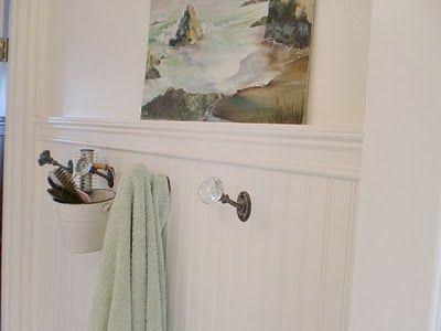 Vintage door knobs in bathroom  as hooks