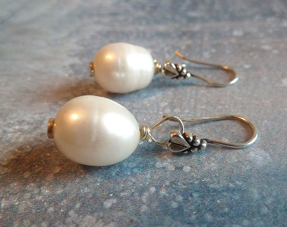 In honor of the classic beauty of Audrey Hepburn. These earrings consist 2 large baroque white pearls with sterling silver ear wire. Great for any attire. xo