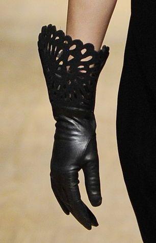 Josie Natori, laser cut cuffs. Found on WGSN.