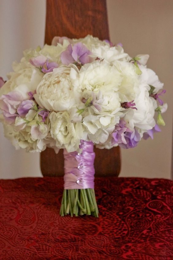 bouquet created with white peonies, white lisianthus, lavender, and lavender sweet peas