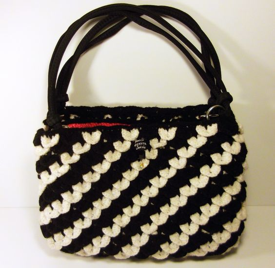 Crocheted black and white crocodile stitch purse.  Check me out on Etsy at https://www.etsy.com/shop/ThePurplePalace.