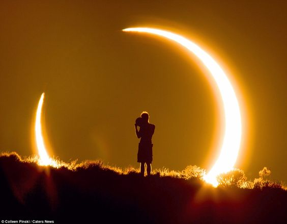 Surrounded by the sun: Stunning image shows boy watching solar eclipse... taken from 1.5 miles away: