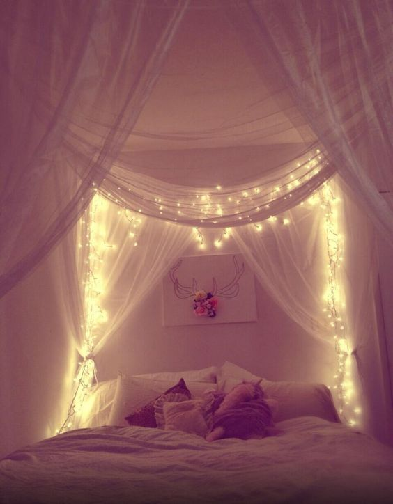 Fairy lights make a bedroom space so magical