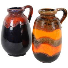Duo of Fat Lava West Germany Pottery Vases in Warm Colors | From a unique collection of antique and modern vases and vessels at https://www.1stdibs.com/furniture/decorative-objects/vases-vessels/