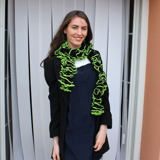 Beautiful crocheted scarf made by Fana's Crafts. It is made of black and neon green acrylic yarn with a generous length for double wrapping. Would make a perfect piece to accessorize your outfit on a party or special night out.
