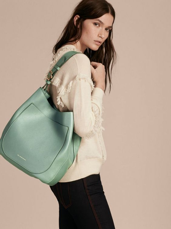 A slim Burberry shoulder bag softly structured from glossy textural leather with a resilient check lining.