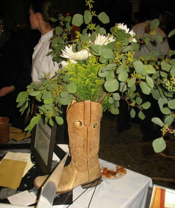 LOVED this floral arrangement in a boot by Mint The Restaurant at Eat Jackson's Bread Pudding Throwdown in Jackson, Mississippi.  http://www.facebook.com/MarisWestBaker  @Eat Jackson,