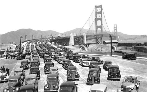 Cars cross the Golden Gate Bridge on its opening day.