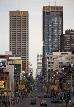 """Looking south on Yonge St., towards Lake Ontario.  Yonge Street (pronounced """"young"""") is a major arterial street in Toronto, Ontario, Canada, and its northern suburbs. It was formerly listed in the Guinness Book of Records as the longest street in the world, and is a national historic site."""