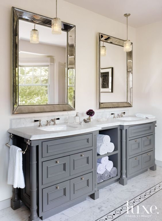 In the master bathroom, Rosenfeld hung a pair of midcentury nickel-and- crystal pendants from Paul Marra above a custom vanity appointed with Kallista sinks. The bath accessories and towels are by Waterworks.