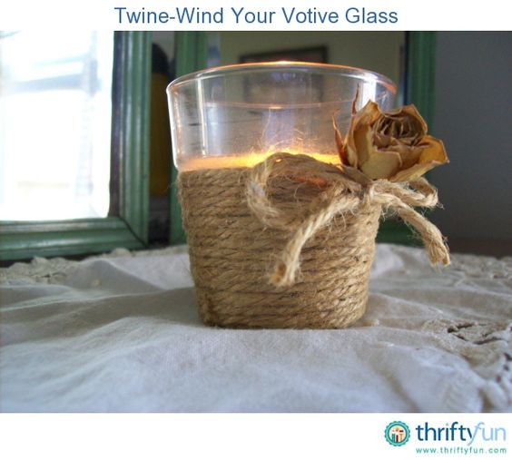 Here's an easy way to give your plain glass votives a rustic chic look using only twine and hot glue.