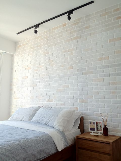 The Result Of Using White Brick Walls Is Just Amazing Because It Combines The Serenity And Neatness O Bedroom Wall Designs Brick Bedroom Track Lighting Bedroom