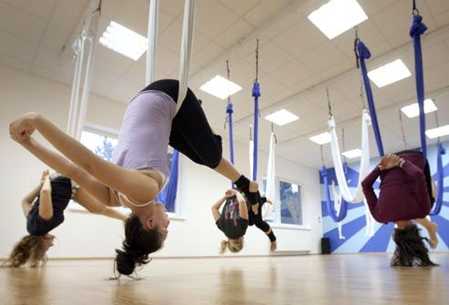 "Aerial Yoga  Yoga blends are a huge fitness trend. This one's name says it all: You do variations on traditional moves while hanging in ""hammocks"" suspended from the ceiling. The weightless poses relieve aching joints and stretch muscles as well as strengthening your core. For other fun twists, try Cy-Yo, a yoga-indoor cycling combo, or YogaFit, which includes squats, sit-ups, and other fitness moves."
