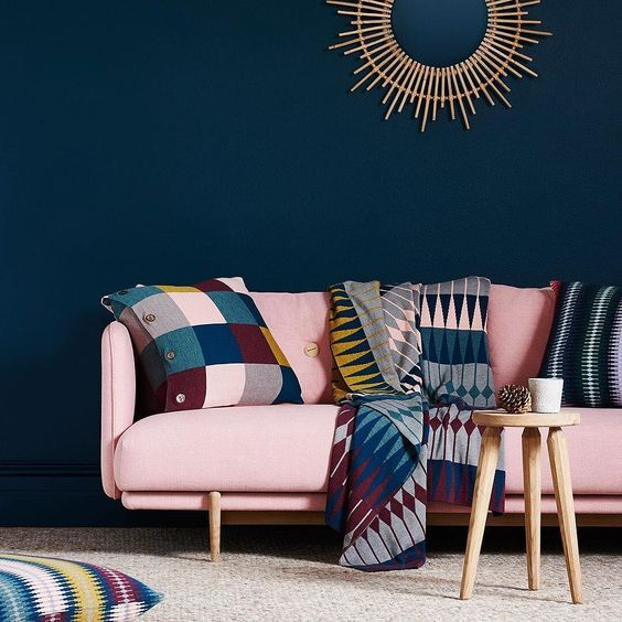 A Sophisticated Living Room With A Navy Statement Wall A Bold Modern Pink Couch And Colorfu Pink Couch Living Room Blue And Pink Living Room Teal Living Rooms #navy #blue #and #pink #living #room