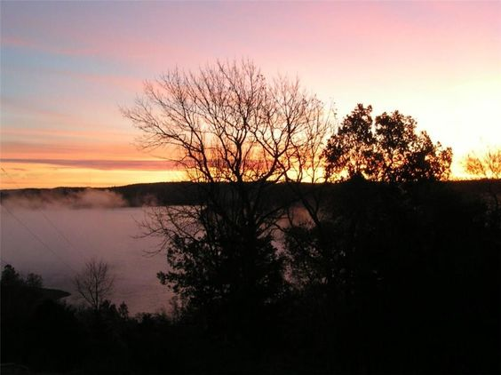 Breathtaking Beaver Lake sunset See lake homes for sale in