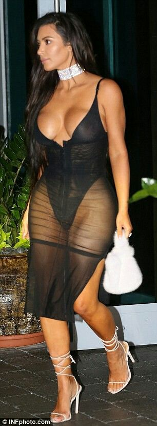 Sheer bodysuit and strappy heels
