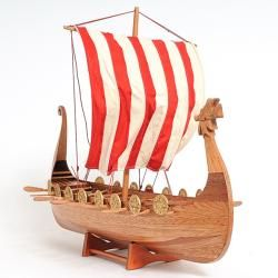 Drake is the name of the Scandinavian boats, which are the inspiration of this model. This particular boat model depicts a kind of whale fishing-boat with a very solid shape, crafted of cedar wood. St
