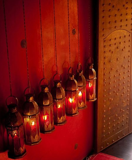 red and brass lanterns with copper and red painted wood