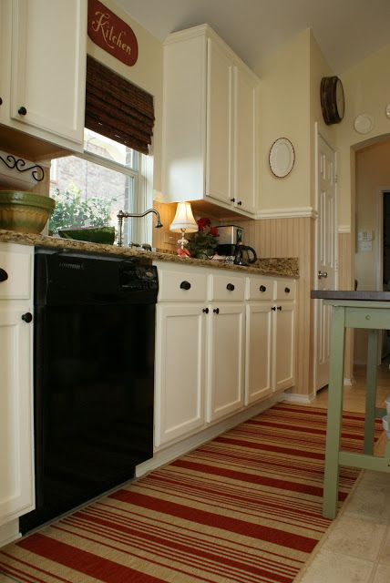 from dark wood cabinets to cream, maybe my kitchen needs this.