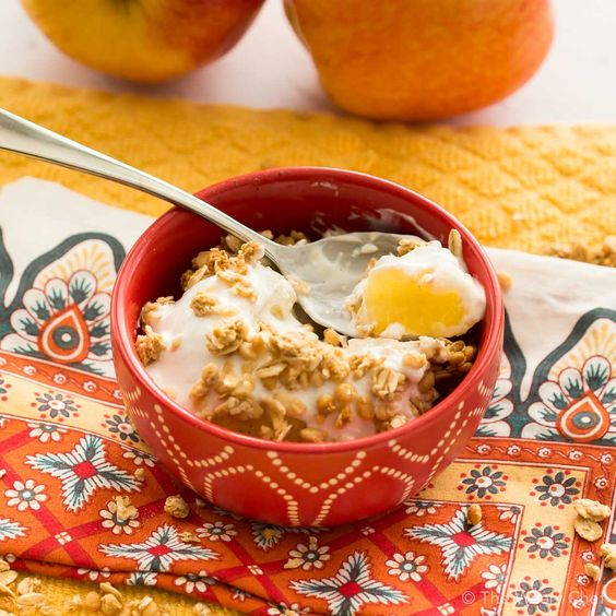 Treat yourself to a baked apple topped with creamy yogurt and crunchy granola, all ready in about five minutes with no added sugar!