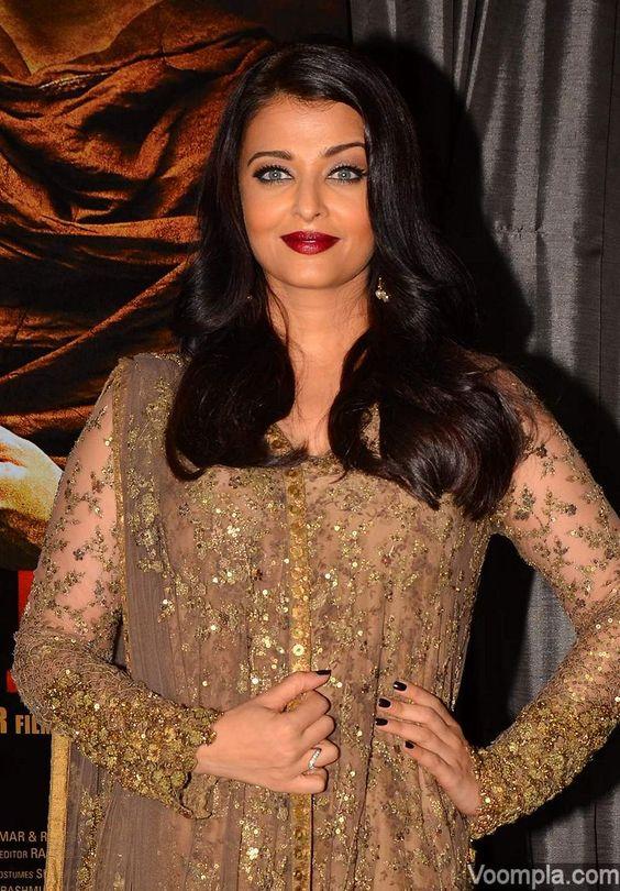 Aishwarya Rai looking gorgeous as always in her traditional avatar - wearing a shimmery brown Sabyasachi salwar suit. via Voompla.com