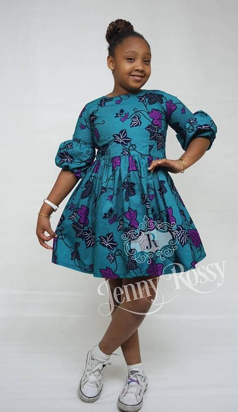 Beautiful African girls dress made from qualityAfrican cotton wax print. This beautiful dress is made to order with your girls exact measurements. Midi dress with 3/4 puff sleeves and gathered wiast No linning. Wrond neck with zipper at the back. Dress is Comfy and soft for your baby Mommy
