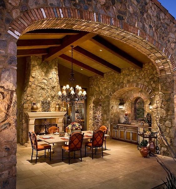 big stone fireplace with dining