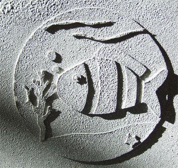 Relief sculpture - additive process. Cut out shapes and paste on, add sand and spray paint.