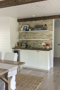 Built in wet bar with stunning tile, open shelves, bead board ceiling and beams eclecticallyvintage.com