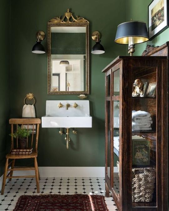 Dark Green Walls In A Vintage Inspired Bathroom Love The Black And White Tile Flooring Green Bathroom Bathroom Wall Decor Bathroom Colors
