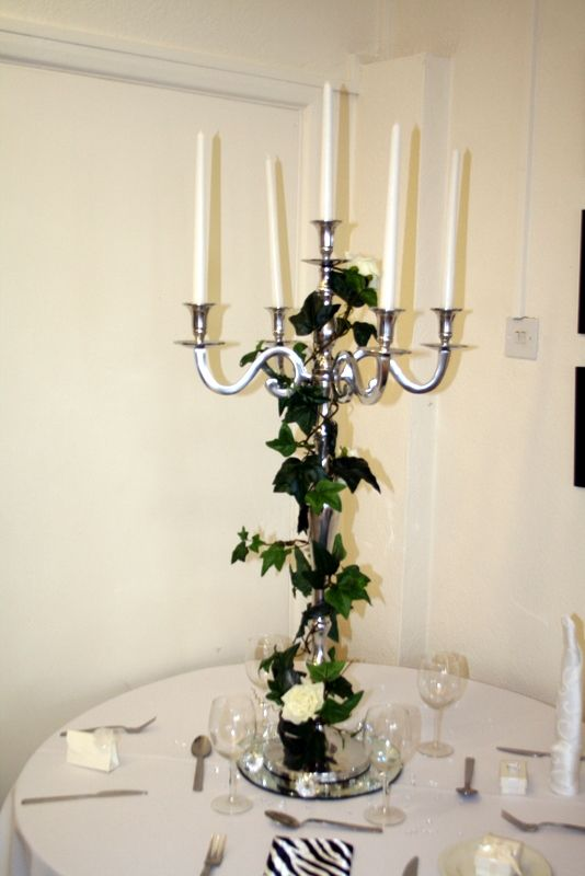 like this candlelabra, like the way the ivy is twisted and just a few roses on it. i would have purple power or freedom roses on it