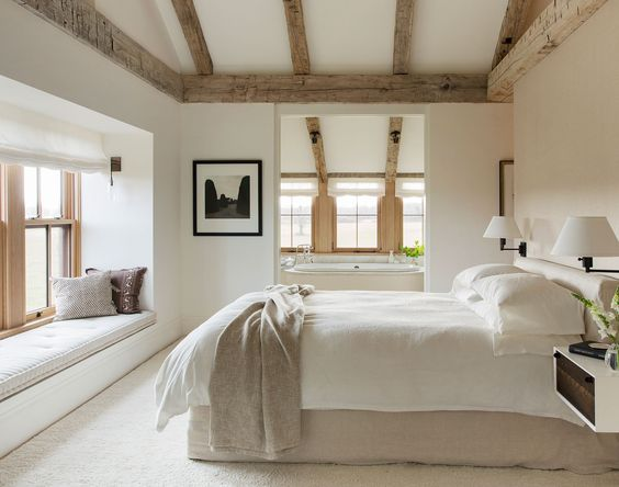 """The master bedroom is scaled for two, and connects the couple with the surrounding land. The custom slip covered bed and natural lines """"are never supposed to look perfect,"""" says Walsh. """"The messier the better."""""""