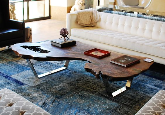 Live edge wood slice coffee table with shiny chrome legs. Love it.