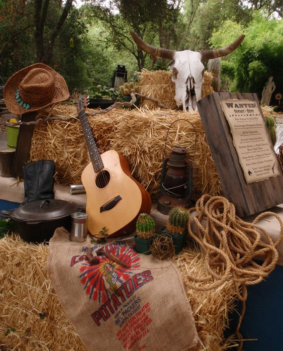 Western Theme must haves: Guitar, cowboy hats, rope, sacks, hay bales, wanted signs, lanterns, etc: