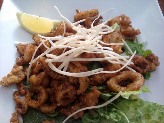 http://www.getnmahbelly.com/2011/07/high-rock-cafe-wisconsin-dells/    This sweet and spicy calamari was first fried till golden brown then tossed in sweet and chili sauce.  #calamari